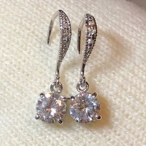 Gorgeous 1.5 carat CZ's dangle Earrings